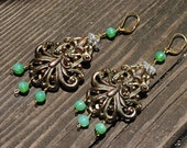 GREEN WITH ENVY -  scrolling gold earrings draped with glowing green vintage beads dangle earrings