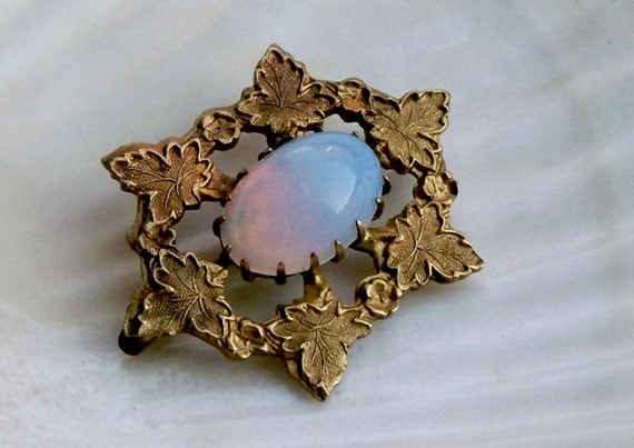 Lovely little opalite and gold tone leaf brooch