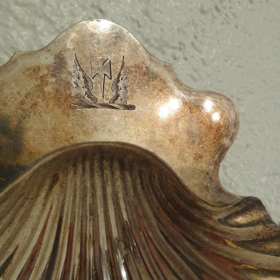 silver shell dish, with a crest