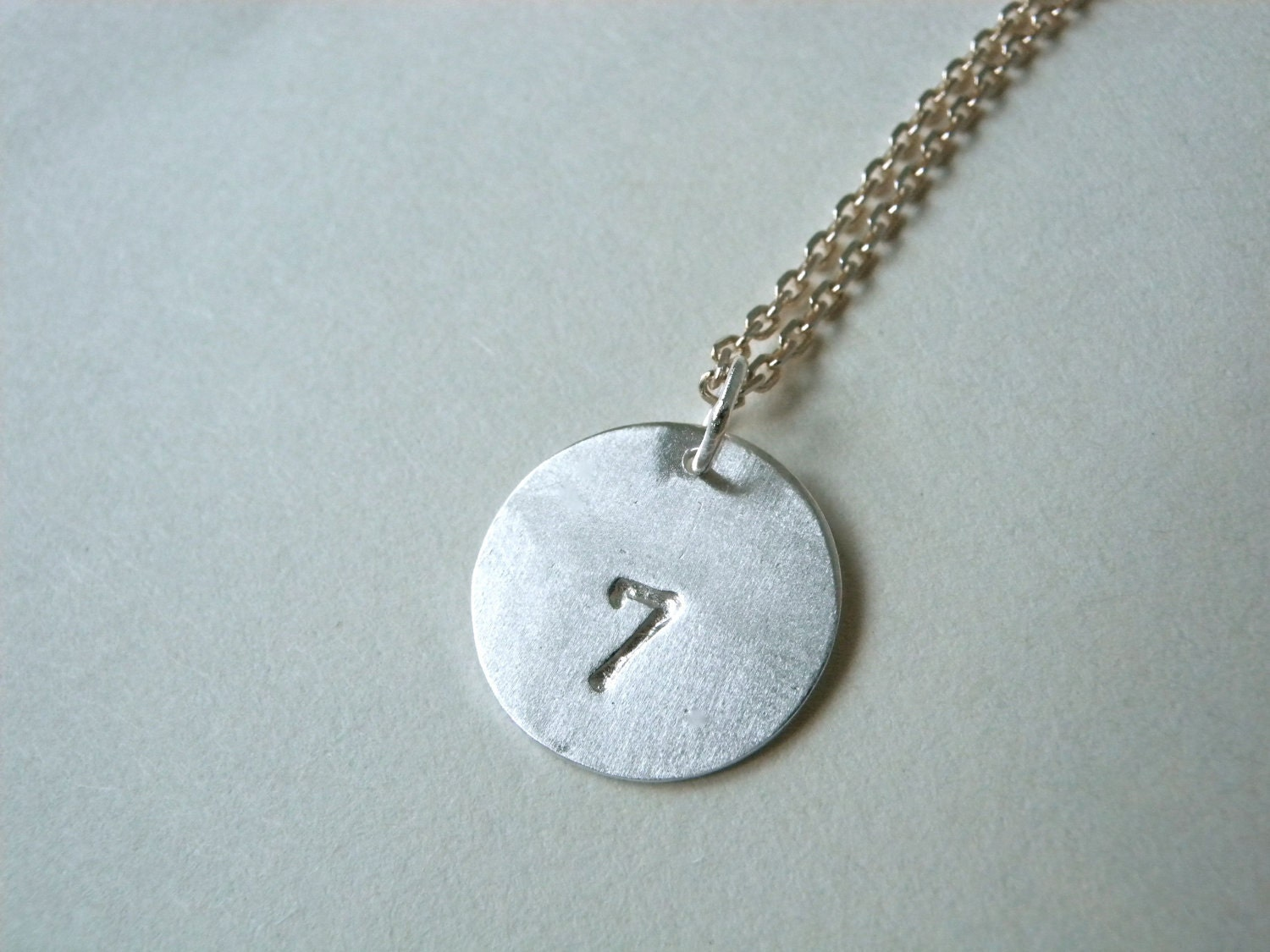 lucky 7 number seven sted silver disc pendant