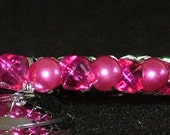 Metal bangle wrapped with glass cerise beads