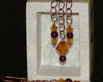 Antiqued copper chain dangle earrings with garnet beads and topaz Swarovksi crystals