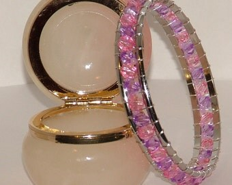 Silver bangle wrapped with pink and lilac beads