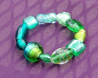 Blue Green stretch bracelet with foiled glass beads