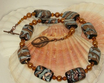 Brown white copper necklace with foiled glass beads