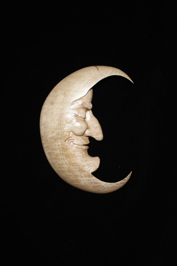 Man in the moon carved curly maple
