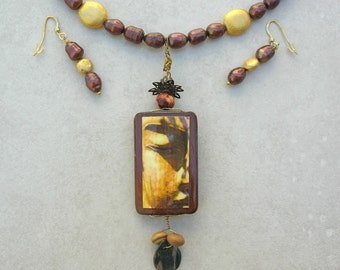 Eye of the Buddha, Reversible Monarch Butterfly/Buddha Pendant, Pearls, Gold, & Petrified Wood Beads,Versatile Necklace Set by SandraDesigns