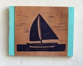 Sailboat printed by hand on reclaimed cedar