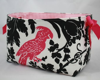 Fabric Bin Hot Pink Parakeet and Black leaves with clear grommets for handles. Pink ribbon added on each side 10 x 5.5 x 6