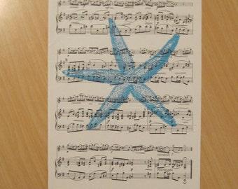 french etoile de mer starfish on coastal chic vintage sheet music