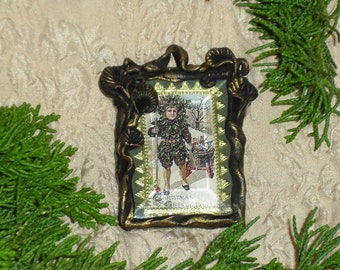 BOY WITH SUIT OF HOLLY - MINIATURE FRAMED PRINT
