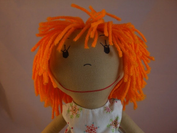 Rag Doll, medium skin tone and a mop of orange hair - Tina in Snow