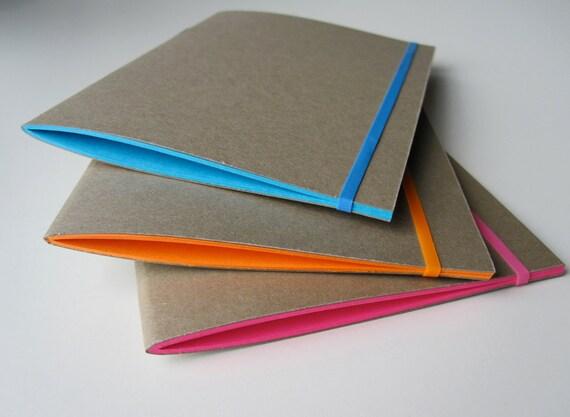 3 Kraft Paper Notebooks in Pink Orange and Blue
