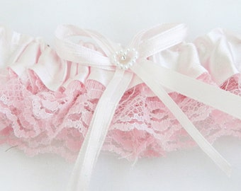 LIGHT PINK Lace Toss Away Garter (1 Piece) with stretchy elastic band. Add your own finishing touches of feathers, flowers and jewelry