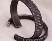 Backlash titanium cuff