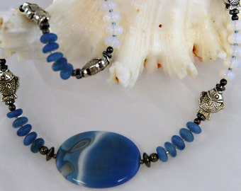 Blue white fish necklace. 30% off-  Moonstone, blue agate, blue quartz, fish beads, Aqua 1135, Nature collection. Matching earrings.