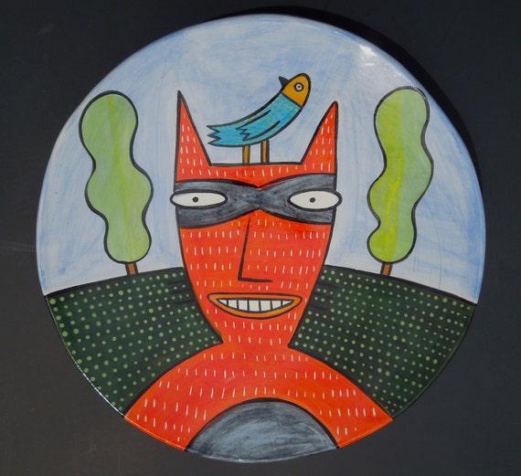 large plate bandit cat w/ bird