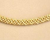 Golden beaded cord choker