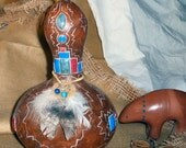 Faux inlaid gourd with Native American feather shield