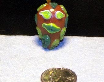 Green man pendant