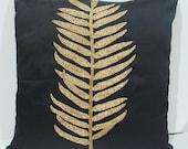 black pillow-botanical leaf design-with gold sequins-art deco style