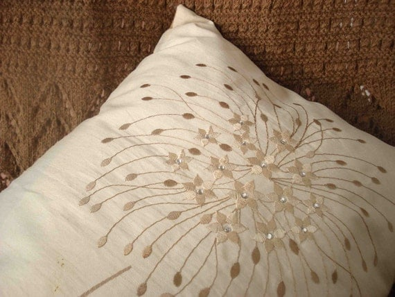 beige embroidery pillow in the size 30cmx45cm