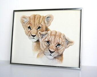 Tiny Tigers Framed Print