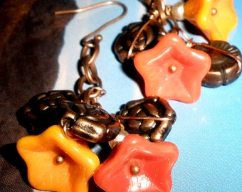 Glass flower earrings in Tangerine, golden yellow, and copper