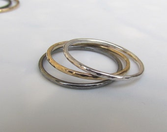A Set of Three Silver and Gold Slim Stacking Rings