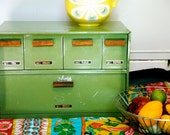 Vintage green metal breadbox with canister drawers
