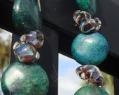 Carol - Beautiful Green Stones, and Handblown Glass