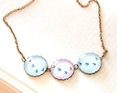 Flying Birds Necklace. Pastel Colors Pink & Blue. Glass Dome, Antique Brass. Flock of Birds, Sky, Flight. - JujuTreasures