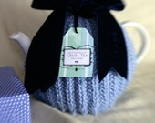 Rude hand knitted alpaca blue tea cosy with velvet ribbon