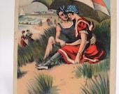Vintage postcard, couple on the beach, 1920s