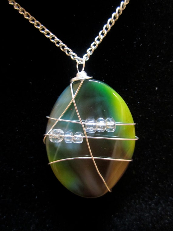 Green and black Polished stone pendent with silver wire with free shipping