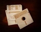Floppy Disk Coasters (w/custom engraving) by Vectorcloud