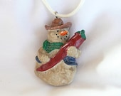 Chilli Pepper Toting Cowboy Snowman Holiday Necklace