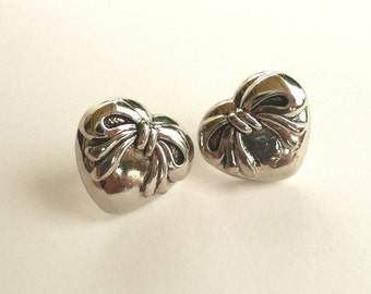 ns-CLEARANCE - Silver (color) Heart w/Bow Stud Earrings