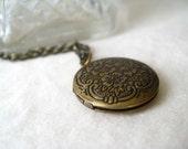 grace's locket necklace, working locket, detailed round design, dangle necklace, antique brass keepsake, cute jewelry gift idea
