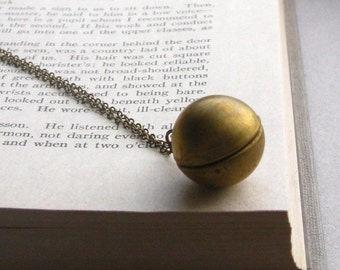 the magician's locket necklace, round ball locket charm necklace, dangle necklace, antique brass, cute jewelry gift idea