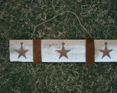 3 Rusty Stars with Cow Hide Strips Wall Hanging