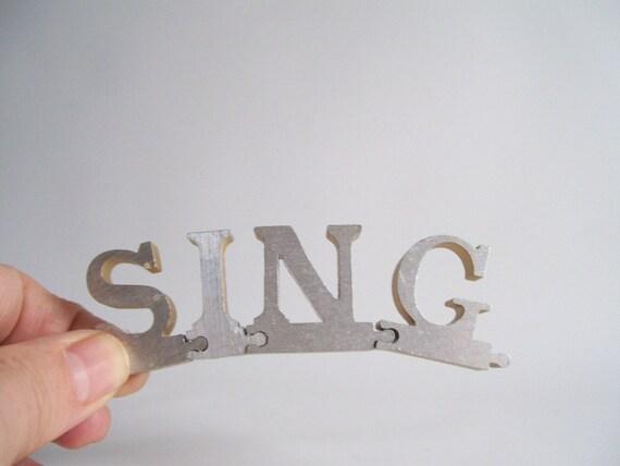 vintage sing puzzle pieces metal letters word home decor sign positive message text type font silver retro home decor