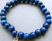 Mens simple dark blue wooden beaded stretch bracelet with hand stamped Initial tag