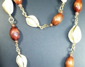 SALE 30 PERCENT OFF - 34 inch vintage Cowrie Shell and wooden bead necklace