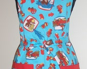 Curious George boys apron with reversible red solid and red pockets