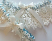 The JILLIAN Garter Set in Heirloom Ivory Venise Lace and Peek-a-Boo Blue Band with Ivory Satin Ribbon Bow Topped with a Pearl