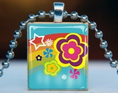 Scrabble Tile Pendant . Bright Retro Rainbow with Flowers on teal 0508