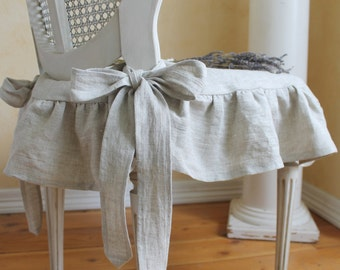 The Isabella Ruffled Linen chair slipcover with ballerina ties in natural linen
