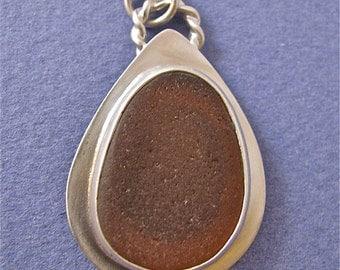 Burnt orange beach glass bezel set sterling silver pendant necklace
