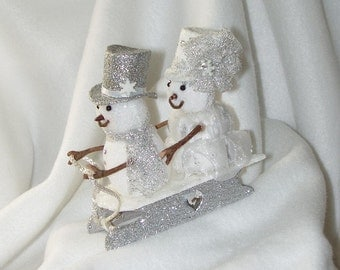 Snowman Couple on a  Sled  Wedding Cake Topper